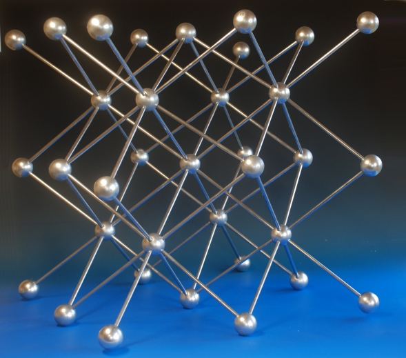 A large crystal structure model of potassium with the body centred cubic structure made with wood balls and aluminium rods