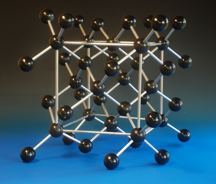 A large crystal structure model of Diamond, showing the unit cell, made with large wooden balls and aluminium rods